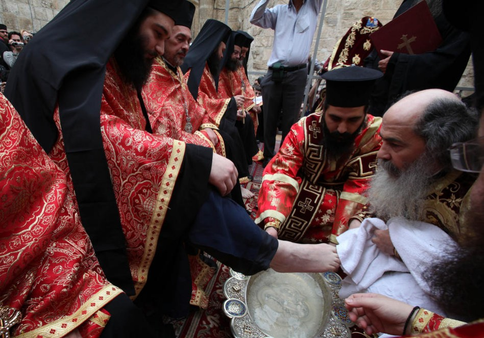 Greek Orthodox priests attend the traditional washing of the feet ceremony at the Church of the Holy Sepulchre in Jerusalem's old city on April 21, 2011. Christians around the world are marking the Holy Week, commemorating the crucifixion of Jesus Christ, leading up to his resurrection on Easter. AFP PHOTO/GALI TIBBON